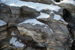 La neige a couvert des roches Images libres de droits