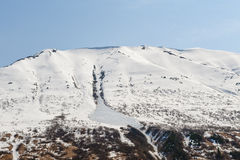 La neige a couvert la montagne Photos libres de droits