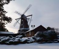 La neige a couvert le moulin à vent Photographie stock libre de droits
