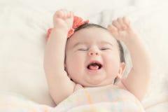 Bebé que sonríe Fotos de archivo libres de regalías