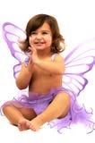 La niña con ángulo púrpura se va volando sentarse y el SM Imagenes de archivo