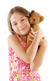 La niña con el peluche refiere blanco Imagenes de archivo