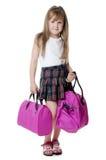La niña con un bolso de la lila aislado Imagen de archivo