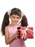 La niña con un regalo Fotografía de archivo