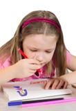 La niña dibuja a la madre Fotografía de archivo