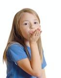 La niña envía un beso del aire Imágenes de archivo libres de regalías