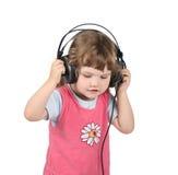 La niña escucha la música Foto de archivo libre de regalías