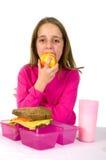 La niña está almorzando Fotografía de archivo libre de regalías