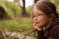 La niña está pensando Imágenes de archivo libres de regalías