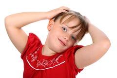 La niña feliz con las manos en su pelo aisló Imagen de archivo