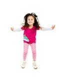 La niña linda salta. Imagenes de archivo