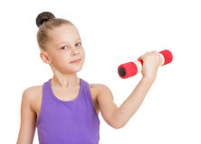 La niña sacude su bíceps Fotos de archivo libres de regalías