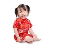 La niña sonríe sobre el fondo blanco Imagen de archivo libre de regalías