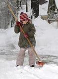 La niña sopla nieve Imagenes de archivo