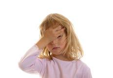 La niña tiene dolor de cabeza Fotos de archivo libres de regalías