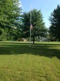 La nostra bandiera visualizzata al mezz'asta Fotografia Stock
