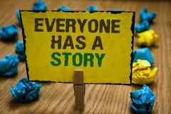 La nota de la escritura que muestra todo el mundo tiene una historia Narración de exhibición del fondo de la foto del negocio que imagen de archivo