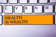La nota di scrittura che mostra la salute è ricchezza La foto di affari che montra essendo nel soggiorno di grande valore di buon Fotografie Stock Libere da Diritti