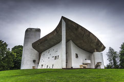 La Notre Dame du Haut, Le Corbusier. Le Corbusier's chapel of Notre Dame du Haut on a rainy day, France Royalty Free Stock Images