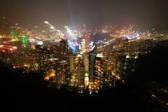 La notte dell'isola di Hong Kong compie con la presa leggera mentre esplodono lo zoom len Immagine Stock Libera da Diritti