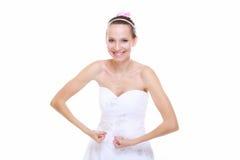 La novia de la muchacha muestra su fuerza muscular y poder Imagenes de archivo