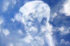 La nube le gusta el rostro humano Foto de archivo