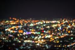La nuit abstraite Defocused de ville de ChiangMai allume le fond Images stock