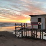 La O.N.U del ocaso de Baywatch la playa foto de archivo libre de regalías