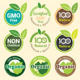 La OGM no OGM libre y etiqueta orgánica de la garantía etiqueta la etiqueta engomada del emblema Imágenes de archivo libres de regalías