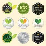 La OGM no OGM libre y logotipo orgánico de la etiqueta de la garantía etiqueta el sti del emblema Imagenes de archivo