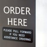 La orden aquí firma Imagen de archivo libre de regalías