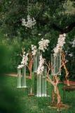 La orquídea de la ceremonia de boda florece la decoración Imagen de archivo libre de regalías