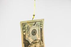 La pêche avec le billet de banque des 20 dollars leurrent sur l'hameçon Photo stock
