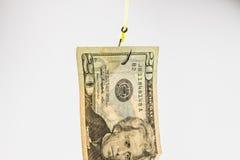 La pêche avec le billet de banque des 20 dollars leurrent sur l'hameçon Photos libres de droits