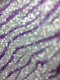 La púrpura ligera del bokeh raya el fondo Fotografía de archivo libre de regalías