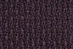 La púrpura oscura hizo punto el fondo de lana con un modelo del paño suave, lanoso Textura del primer de la materia textil Imagen de archivo libre de regalías