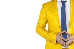 La pace emana da un uomo d'affari, un vestito dell'oro, fondo bianco fotografia stock
