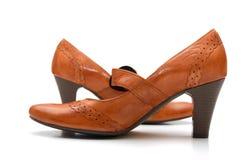la paire en cuir chausse la femme Image stock