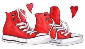 La paire rouge d'espadrilles d'aquarelle chausse l'amour de coeurs Photo stock