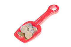 La pala del giocattolo ha riempito di euro monete Fotografie Stock