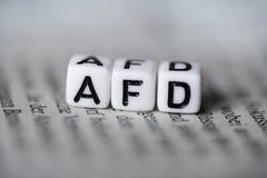La palabra AFD formó por los bloques de madera del alfabeto en política de partidos del alemán del periódico imágenes de archivo libres de regalías