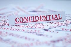 La palabra confidencial. Fotos de archivo