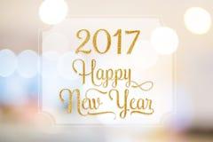 La palabra de la Feliz Año Nuevo 2017 en el marco blanco en el extracto empañó el boke Imagenes de archivo