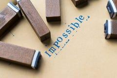la palabra de la letra del alfabeto imposible de sello pone letras a la fuente en el papel imagen de archivo libre de regalías