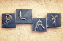 La palabra JUEGO hecho de letras del metal Fotografía de archivo