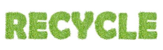 La palabra RECICLA de la hierba verde Imagen de archivo
