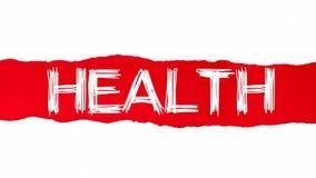 La palabra SALUD que aparece detrás del papel rasgado rojo stock de ilustración