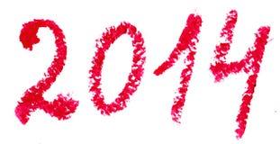 La palabra 2014 se escribe con el lápiz labial. Aislado en blanco Foto de archivo