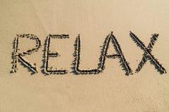 La palabra se relaja en la playa Fotografía de archivo