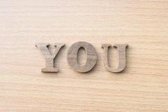 La palabra USTED del alfabeto de madera Fotografía de archivo libre de regalías